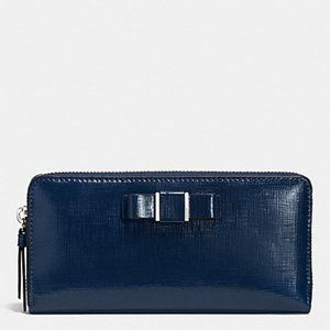 DARCY PATENT BOW ACCORDION ZIP WALLET Blue Silver